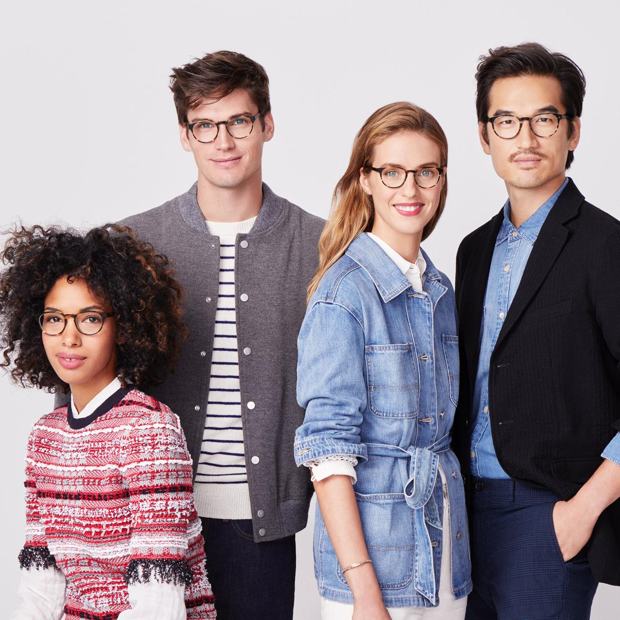 four people wearing fall clothing and glasses