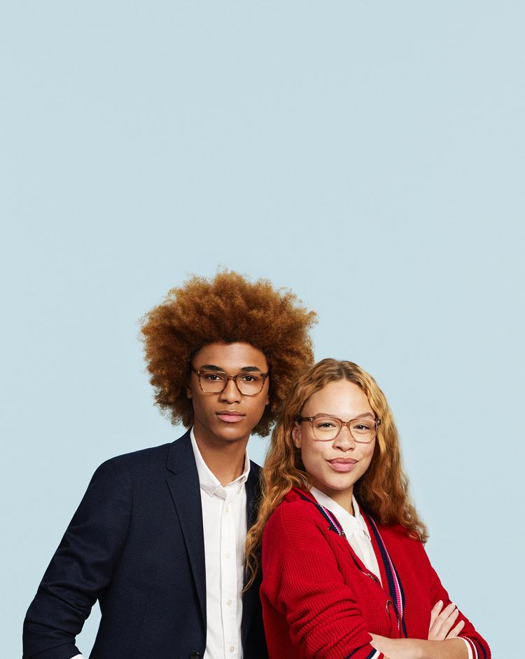 Man and woman next to each other wearing glasses